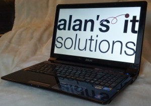 Alan's IT Solutions displayed on a laptop